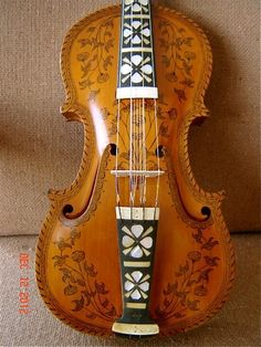 1912 Norwegian Hardanger Fele (fiddle) with sympathetic strings -- that resonate in the droning songs of Norway.