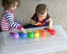 Baby Play:  Exploring Sticky from Fun at Home with Kids. contact balls blocks and feathers