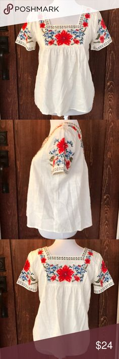 Abercrombie kids embroidered short sleeve tunic Absolutely beautiful and In EUC floral embroidered short sleeve tunic top from Abercrombie kids. Flowy and flattering. abercrombie kids Shirts & Tops Blouses