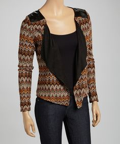 Get all dolled up in this stylish cardigan! Featuring an eye-catching pattern and an open silhouette, the sophisticated layer effortlessly meets a chic ensemble's needs.Measurements (size S): 21'' long from high point of shoulder to hemSelf: 100% polyesterLining: 35% viscose / 65% polyester Hand wash; dry flatImported