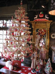 Vintage german white feather christmas tree. Arms Musuem Youngstown Ohio
