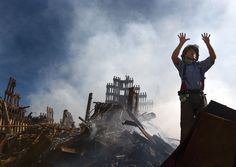 Firefighter calling for 10 additional rescue workers to make their way into the rubble of the World Trade Center in New York City following the September 11, 2001, terrorist attacks.