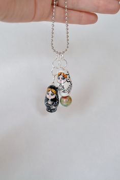 Add some quirk to any outfit with the fast and simple matryoshka doll necklace @penelopen