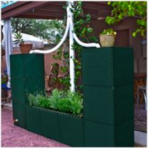Just another idea on how you can Build your own Barrel! NO OVER-FLOW, mosquitos, algae , or leaves & debris- NO MAINTENANCE! Freeze-proof FULL OF ICE in the winter and UV resistant in the hot summer sun! This design holds 150 gallons of rain water all while growing a raised veggie bed!