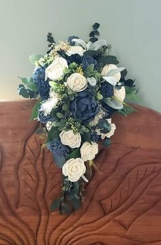 Sola wood flower cascading bouquet with accent colors as navy blue and dusty blue. Color match with Davids bridal steel blue. 11 inches wide by 18 inc. Wedding Bridesmaid Bouquets, Cascading Wedding Bouquets, Blue Wedding Flowers, Wedding Flower Arrangements, Bridal Flowers, Wedding Centerpieces, Tall Centerpiece, Cascading Flowers, Bridal Bouquets
