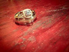 Brides ring + groom's wedding band. Wedding band made to look like back of aggie ring. Aggie wedding!