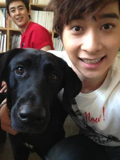 Chansung and Nichkhun snap a photo with a dog while on set #allkpop #kpop #2PM