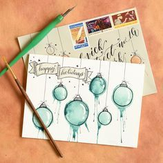 Artistic Ornaments-Themed DIY Christmas Card Tutorial   The Postman's Knock :: This DIY Christmas card tutorial is quick, easy, and artistic! To make this project, you'll just need a few watercolor paints, a blank card, and lung power!