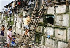 Can you imagine living like this. Tomb Raiders - Residents climb into their houses atop gravestones inside a cemetery in Manila. Many poor urban dwellers make their homes in public cemeteries, converting abandoned tombs and mausoleums into houses. Manila, La Danse Macabre, Old Cemeteries, Graveyards, Unusual Homes, Slums, Photos, Pictures, Belle Photo