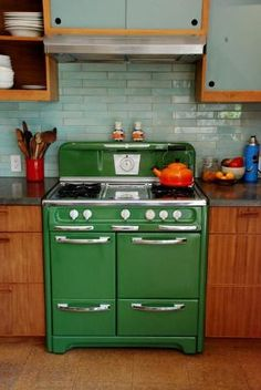 Gorgeous aqua glass tile backsplash. (cool stove, too)