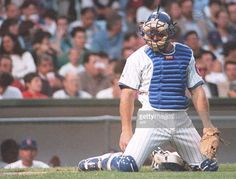 Chicago Cubs catcher Rick Wilkins kneels after missing the tag at homeplate which scored San Francisco Giants' Kirk Manwaring giving the Giants a 3-1 lead over the Cubs in the top of the fifth inning. The Giants won 8-4. AFP PHOTO