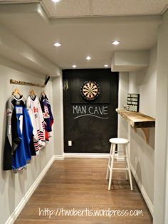 chalk board wall + dart board + hockey basement + rustic bar, where there is a man cave there is a women's Spa, so i approve of this lol.
