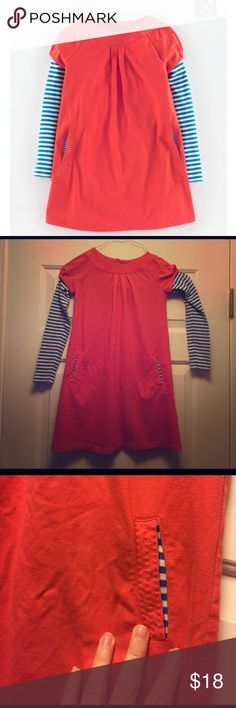Mini Boden red tunic dress blue stripe sleeves Adorable Mini Boden red tunic dress with blue striped sleeves. Super cute with leggings. Soft and cozy, two button back, pockets lined with contrasting fabric, so great. Worn once--daughter preferred her blue one.  Color is pinky red, not cherry (that was the issue. 🙄) Mini Boden Dresses Casual