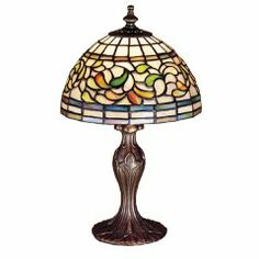 Subtle toned Autumn Gold, Russet and Moss Green leaves swirl against an Amber Mauve background in this stained glass Tiffany Studio reproduction. This elegant mini lamp, with Mahogany Bronze finished base, will complement any decor. Stained Glass Table Lamps, Tiffany Stained Glass, Tiffany Glass, Tiffany Style Table Lamps, Kitchen Lamps, Candelabra Bulbs, Lamp Design, Turning, Green Leaves