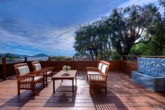 Beautiful clean, simple deck with a gorgeous view and tranquil water feature