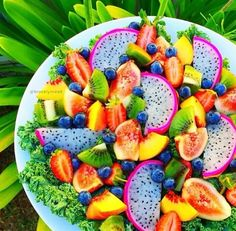 Fruit Salad with Green Kale, Kiwis, Blueberries, Strawberries, Peaches, Figs, and Dragon Fruit