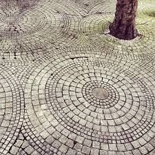 Image result for circular cobblestone paving