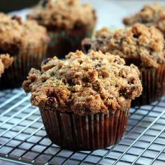Healthy banana chocolate chip muffins with a pecan brown sugar crumb topping...