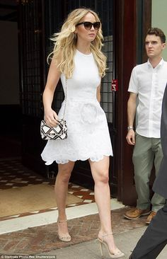 Leggy Jennifer Lawrence in a little white dress and high heels