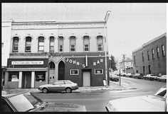 South Main Street, Stillwater, MN. Circa 1970's. John's Bar & The Croixside Press. My mother worked next door at the Wordsmith for Harriet Johnson, who I believe owned both buildings. Once, my brother Pete was sent up above John's to clean out an apartment of someone who supposedly skipped rent and left. Well when my brother was forced to break into the apartment he found a very ripe and expired tenant who had died of a massive brain hemorrhage. Very unpleasant indeed.