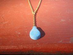 Blue tinted Faux Bone water drop on gold by QuailHollowForgings
