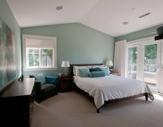 Turquoise blue bedroom walls. Benjamin Moore Wythe Blue HC-143. Painting by Warline Painting Ltd.
