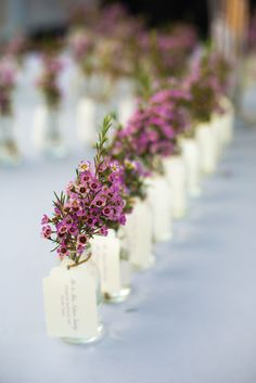 Bunches of Purple Wax Flowers served double duty as #EscortCards | See the wedding on SMP: http://www.StyleMePretty.com/little-black-book-blog/2014/02/03/brooklyn-botanical-garden-wedding/ Photography: Ava Weddings