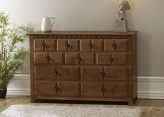 Sturdy wooden 11 drawer chest of drawers available in a range of paint and natural wood finishes including solid oak. Perfect Bedroom, Bedroom Storage, Drawers, Storage Solutions Bedroom, Furniture, Wooden Chest, Luxury Sideboard, Bedroom Furniture, Handmade Bedroom Furniture