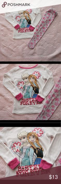 Disney Frozen Anna & Elsa Sisters Forever Pjs Set Great condition. 100% Cotton. Anna and Elsa print on a white long sleeve shirt. Hot pink trim. Pink and glitter sisters forever.  Pants are grey with hot pink snow flakes. Size 5T. Bundle in my closet and save! Disney Pajamas