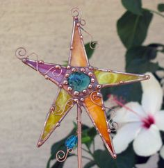 Stained glass and copper garden art plant stake