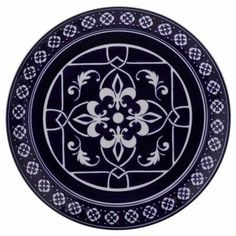I'm a Kappa Kappa Gamma alum—dark blue is one of our colors and the fleur-de-lis is one of our symbols, so I love this dining set from Target. (I even bought this plate to display in my bedroom)