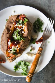 Tired of sweet potatoes topped with marshmallows? Try out these savory baked sweet potatoes stuffed with feta and sun dried tomatoes.