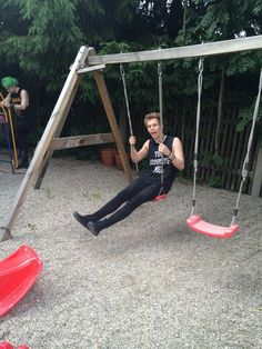 Luke. No. Can you not.>> lol I'm surprised he didn't break the swing! :p he's just too cute!> and then there is Michael in the back :)