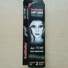 Lady Gaga brushbuddies Got it as a gag gift, but never gave it to the recipient.  Singing  toothbrush that plays 2 full songs from lady Gaga.  Born this way and Bad romance. There is a play and stop button and also a repeat  button.  Still in the box NEVER OPENED. brush buddies  Other