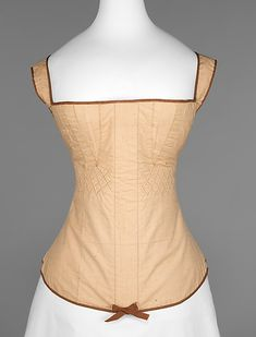 Tan cotton corset with brown piping, American, 1815-1825.