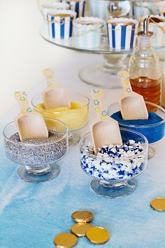 The symbols and colors of Hanukkah decorate these wooden scoops from Sucre Shop and make a lovely pair with the sprinkle bowls.