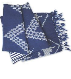 'BLUE JEPARA' - IKAT BLANKET. $35 Hand-loomed Ikat blanket. Ikat is a type of textile characterized by the unique dye-resist process used to make it. Threads are tie-dyed before weaving to prevent dye from adhering to the threads, creating the design. This textile was made in Jepara (Central Java) using a pedal loom. The motifs are typical from Lombok. www.doroteagale.com