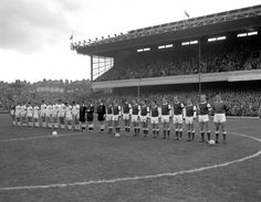 Arsenal and Blackpool players line up in the centre-circle in order to observe a minute's silence in memory of assassinated American president John F. Kennedy (1963)
