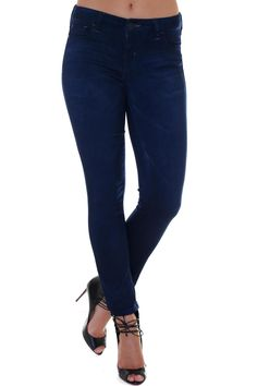 Slim and sexy. Every wardrobe staple deserves an update, and the Elan Skinny Indigo Denim are the perfect stylish update. A classic 5 pocket styling with zip and button front closure, the slim fit and dark color allow this updated basic to be a true everyday go-to.   Dark Wash Jegging by Elan USA. Clothing - Bottoms New York