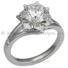 """Artistic Snowflake Engagement Ring -    Just like each snowflake that falls from the sky, your Snowflake Engagement Ring will be unique; it will be made just for you. This """"snowflake"""" consists of six prong-set princess cut diamonds surrounding a round brilliant cut diamond."""