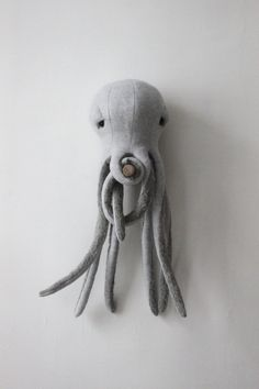 The Small Octopus, all cute and kind!  Perfect companion for your little boy or the missing link in the kingdom of your little princess... or just to