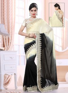 Real splendor will come out from your dressing style with this cream and black faux crepe and faux chiffon designer saree. Beautified with embroidered, patch border and resham work all synchronized we...