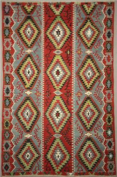 Antique kilims were made by strong interweaving of the weft and warp to make a smooth surface without pile. The horizontal wefts were pulled down in a strong fashion that covers the vertical warp fibers. Turkish Kilim Rugs, Persian Rug, Rug Store, Kilim Cushions, Tapestry Weaving, Ancient Civilizations, Rugs On Carpet, Wool Rug, Bohemian Rug