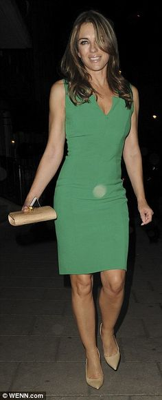 Stunner: Elizabeth looked phenomenal in the emerald-coloured dress which was cut to her figure perfectly, with a cheeky slit at the neck giving a hint of cleavage