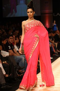 Anita Dongre, coveted for bridal couture, handcrafted luxury pret and menswear, derives inspiration from the splendid crafts of Rajasthan and remote villages of India. The top Indian designer's collections online now. Pakistani Outfits, Indian Outfits, Indian Clothes, Indian Attire, Indian Wear, Lehenga, Sabyasachi, Mehndi, Modern Saree