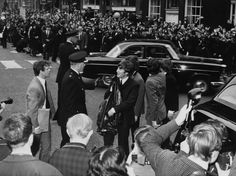 "The Beatles, with John Lennon facing the camera, are pictured at their arrival at the Liverpool Town Hall, Liverpool, England, Friday July 10, 1964, were given a civic reception, before attending the Northern Charity Premiere of their film ""A Hard Day's Night"". Returning home after an absence of seven months, they were welcomed by a crowd of some 150,000 fans lining the eight-mile route from the airport to the town hall. (AP Photo)"