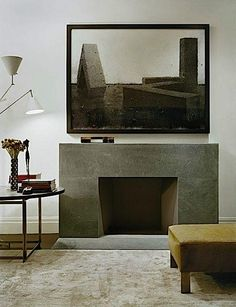 The slate surround of this modern fireplace is echoed by the minimalist style of the painting above in this New York townhouse designed by Rees Roberts + Partners (interiors) and Steven Harris Architects (architecture). Photography by Elizabeth Felicella.