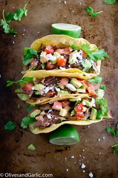 Brisket Tacos with Caramelized Onions |  These are a perfect example of how amazing leftovers can be. Tender shredded brisket, caramelized balsamic onions, shredded lettuce, pico de gallo, guacamole and chipotle crema is a combination made for a taco. It's an easy to make recipe that takes a cheaper cut of meat and turns it into meals for days. @kathysteger1021