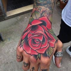 Neotraditional style rose on the hand.