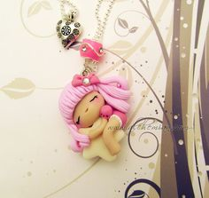 pink fairy ooak necklace made in italy glow in the dark. €25.00, via Etsy.